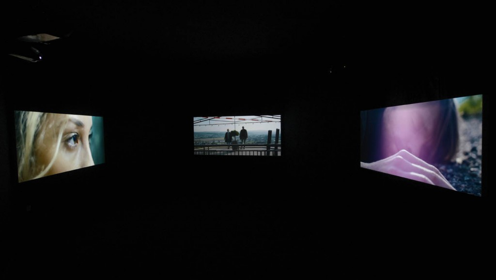 Filip Markiewicz View of the exhibition:  Journey to the End of an Identity,  2015 Full HD film installation synchronized  on 3 x projectors Format 2.35 :1, 35 minutes, variable  dimensions © Filip Markiewicz / Photo: Christian Mosa